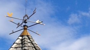 A weather vane stands out against a blue sky like these resources can help you stand out in a digital world